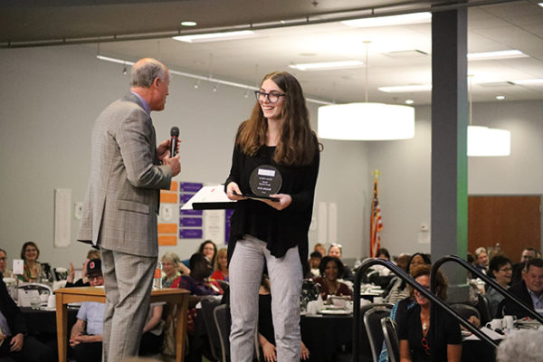 Natalie Artz accepts the Youth Spirit Award, as well as a scholarship, from LifeCare Alliance President & CEO Chuck Gehring at the LifeCare Alliance Volunteer Recognition event on Monday, April 30, 2018. Photo by Anthony Clemente, LifeCare Alliance.