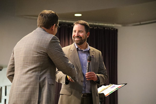 John McHugh, right, accepts the Advancement Spirit Award from LifeCare Alliance Board Member Jeff Fivecoat of Piper Jaffray at the LifeCare Alliance Volunteer Recognition event on Monday, April 30, 2018. Photo by Anthony Clemente, LifeCare Alliance.