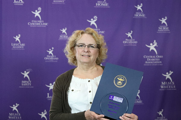 Joan Hess poses with the Farmer's Market Spirit Award at the LifeCare Alliance Volunteer Recognition event on Monday, April 30, 2018. Photo by Andrew Zuk, LifeCare Alliance.