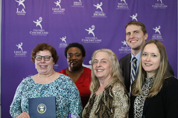 Representatives of Huntington National Bank pose with the Corporate Meal Route Spirit Award at the LifeCare Alliance Volunteer Recognition event on Monday, April 30, 2018. Photo by Andrew Zuk, LifeCare Alliance.