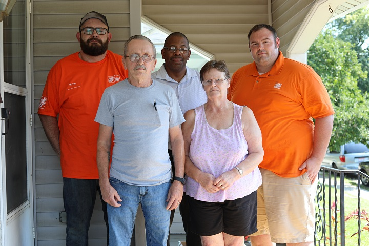 Home Depot representatives with LifeCare Alliance clients and staff