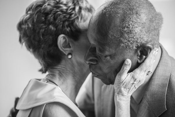 A Loving Touch - Elderly couple embraces