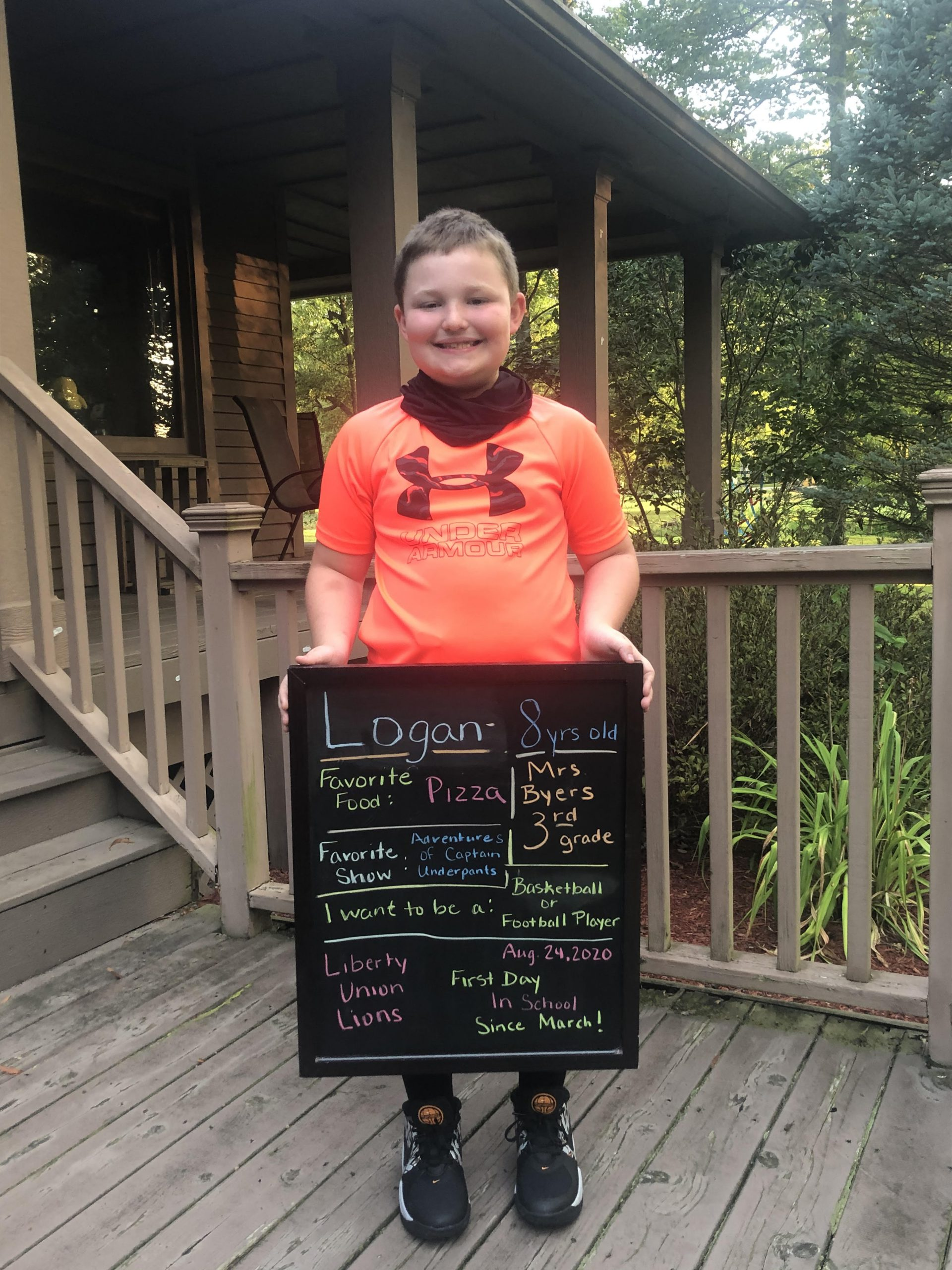 Logan poses on his first day of school