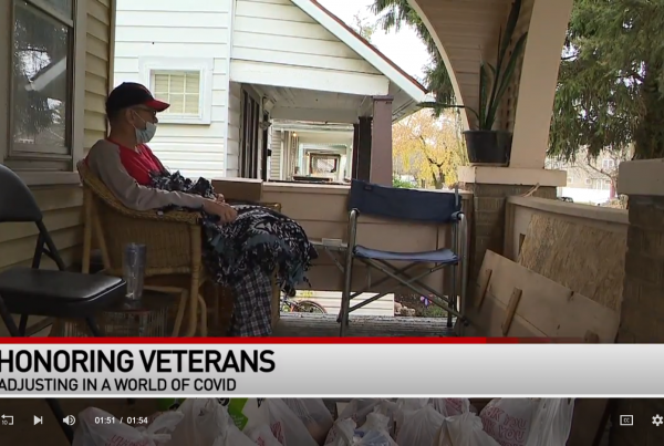 Military veteran shown on his front porch with blanket in lap